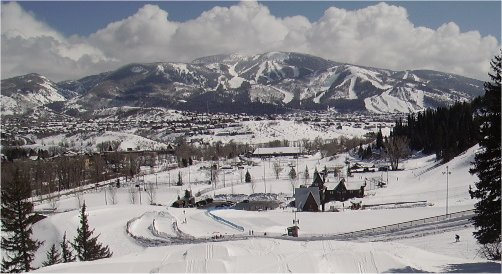 Image of snow covered mountains with ski area